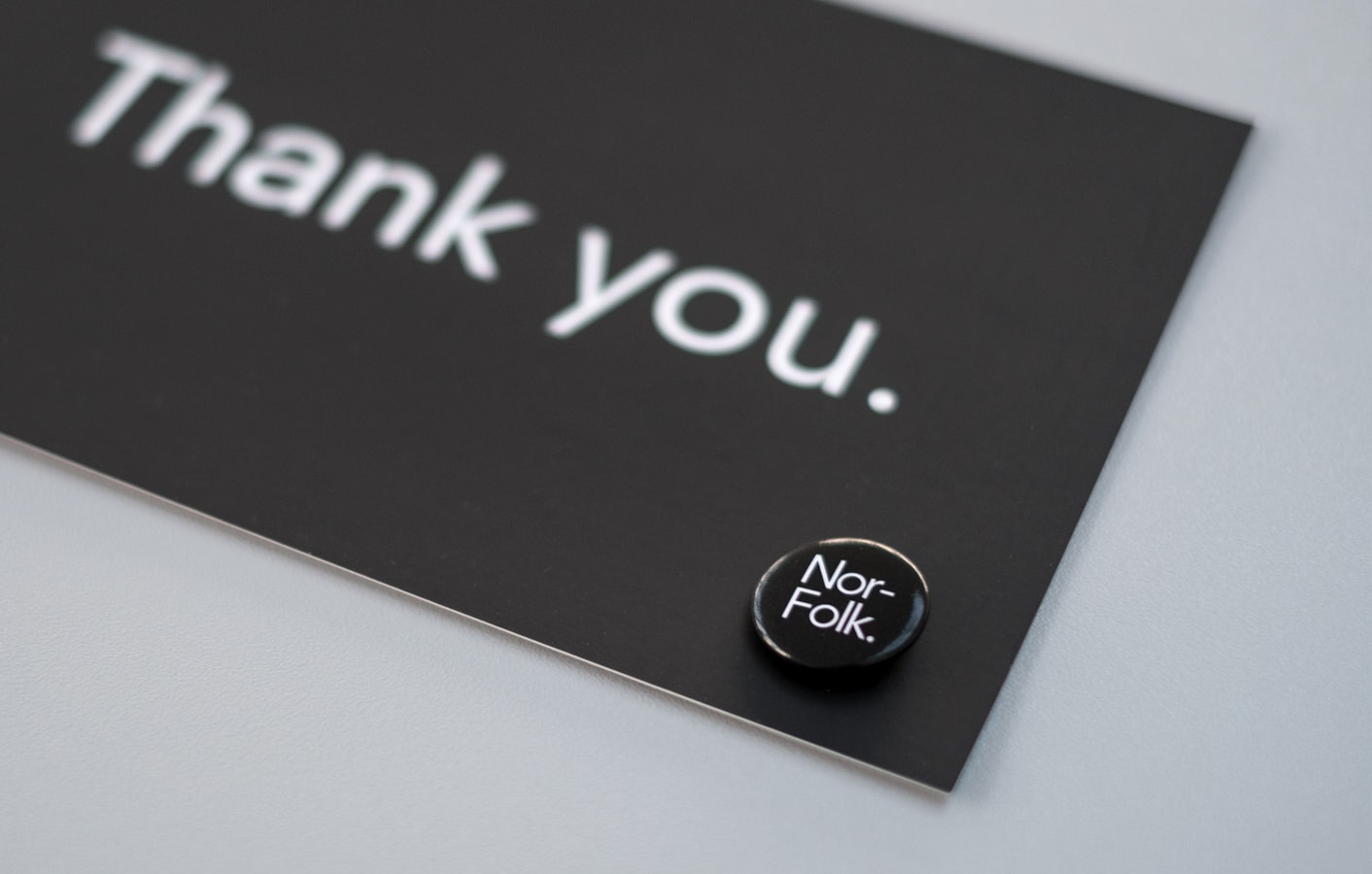 Thank you card and pin badge for Nor–Folk.