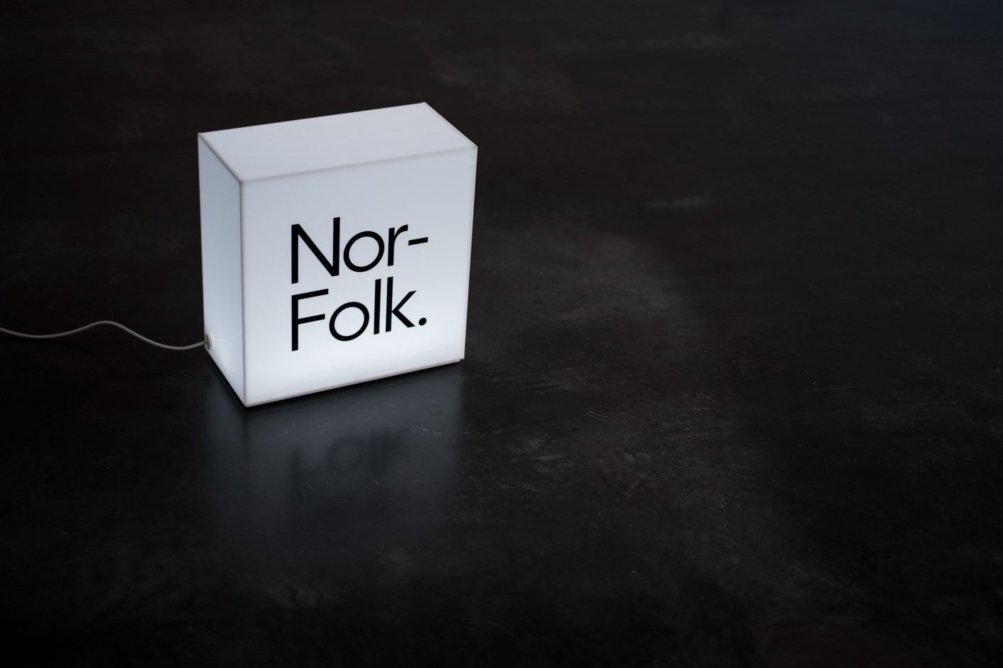 Nor-Folk branded light box sign