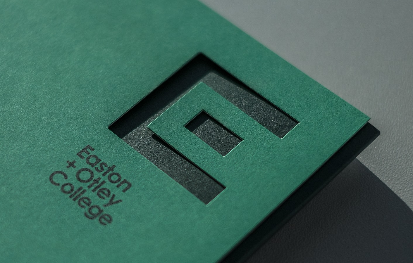 Die cut detail on Easton and Otley College folder.